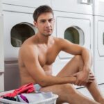 22348639 - portrait of a man with laundry basket waiting to wash clothes
