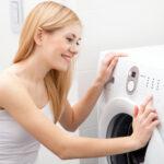 25148040 - young beautiful woman using a washing machine