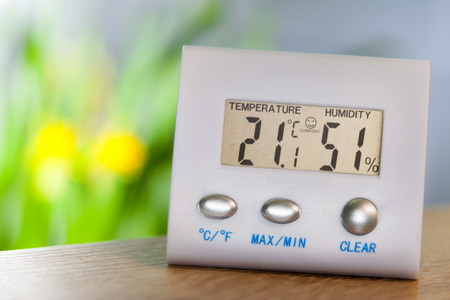 72480245 - hygrometer on a table shows comfort temperature and humidity