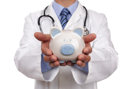 25087787 - doctor holding piggy bank concept for healthcare insurance fees and savings for medical expenses