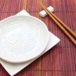 17663171 - white empty plate with chopsticks