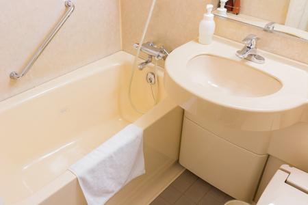 58826421 - luxury wash basin and bathtub in a bathroom, an interior modern design.